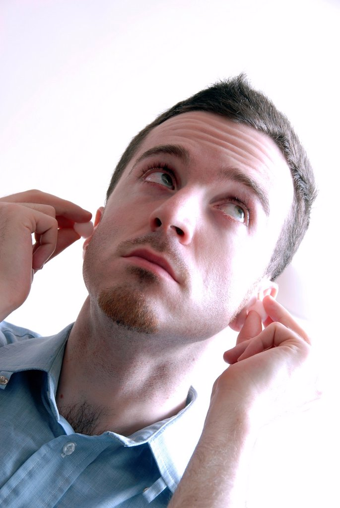 Man with earplug : Stock Photo