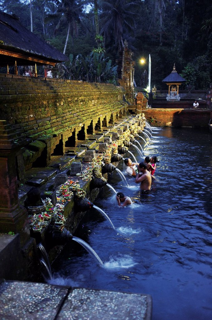 Balinese bath in the sacred waters of Tirta Empul  An ancient natural water spring feeds the baths  This area is believed to be the ancient center of the Subak culture : Stock Photo