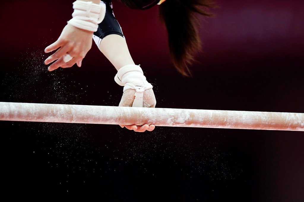 06 08 2012 Olympic Games, London, England, Gymnastics, Asymmetric bars : Stock Photo