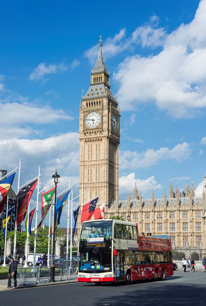 Stock Photo: 1566-1034752 Open top tourist bus passes in front of Big Ben and the Houses of Parliament, London, England