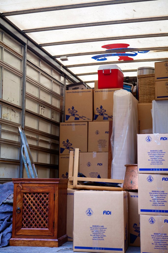 Stock Photo: 1566-1036039 Moving Home - Boxes of belongings in back of truck