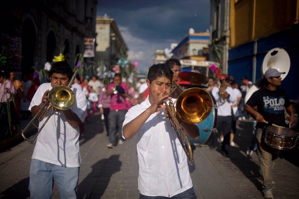A music band performs during the Convite during the celebration of Carmen Alto neighborhood, in Oaxaca, Mexico, July 12, 2012, in this tradition of the Catholic Virgin of Carmel celebrations people walks in the streets of the neighborhood dancing and shar. A music band performs during the Convite during the celebration of Carmen Alto neighborhood, in Oaxaca, Mexico, July 12, 2012, in this tradition of the Catholic Virgin of Carmel celebrations people walks in the streets of the neighborhood danc : Stock Photo