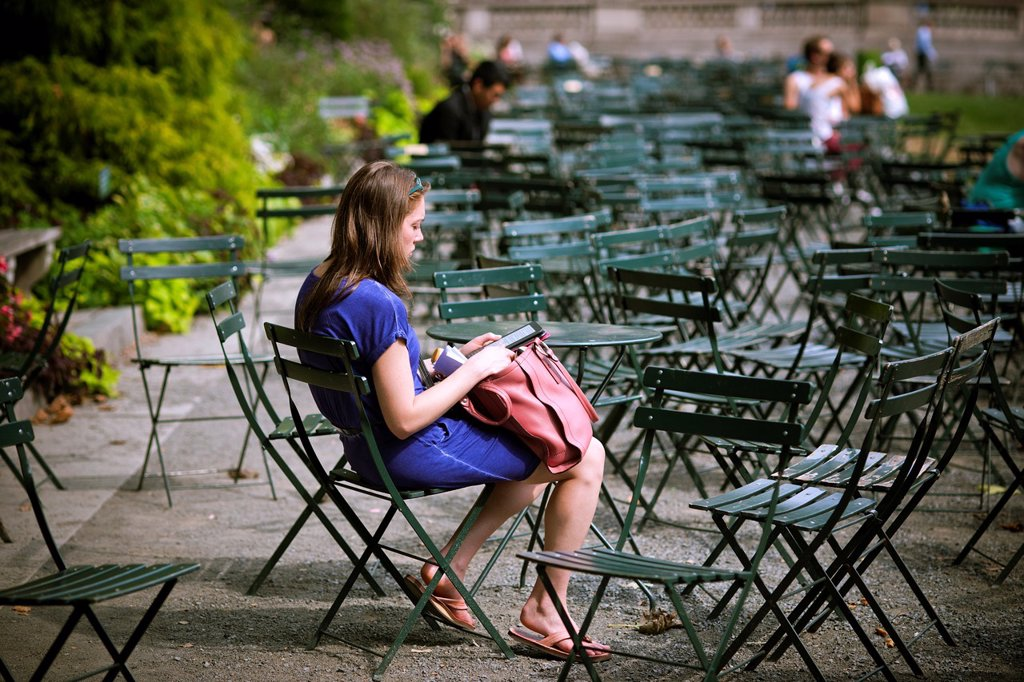 Stock Photo: 1566-1038542 A reader uses her Amazon Kindle electronic book in Bryant Park in New York