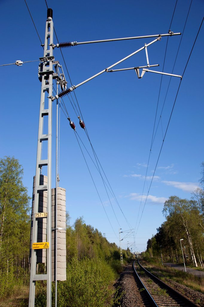 Concrete counterweights hanging from a pulley  This system keeps the railroad´s electric cables in correct tension  Location Oulu Finland Scandinavia Europe : Stock Photo