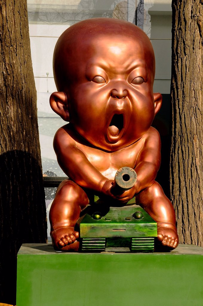 Stock Photo: 1566-1039019 Baby riding a tank sculpture at 798 Art Zone, a square kilometre of converted industrial site in Beijing´s northeastern Chaoyang District, Beijing, China, Asia