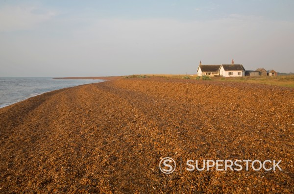Stock Photo: 1566-1039706 Bungalow house on the beach at the coastal hamlet of Shingle Street, Suffolk, England