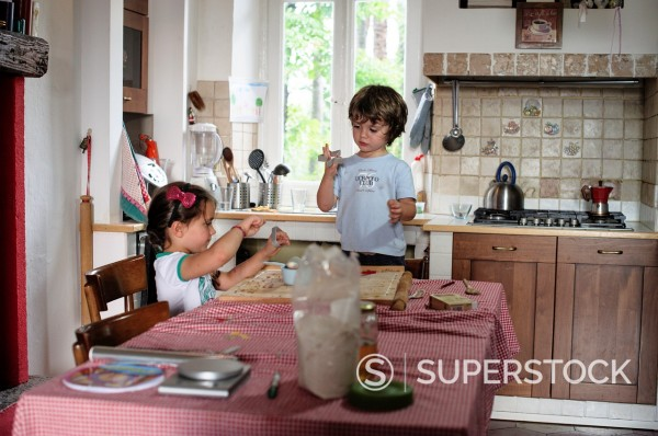 Children prepare cookies in the kitchen : Stock Photo