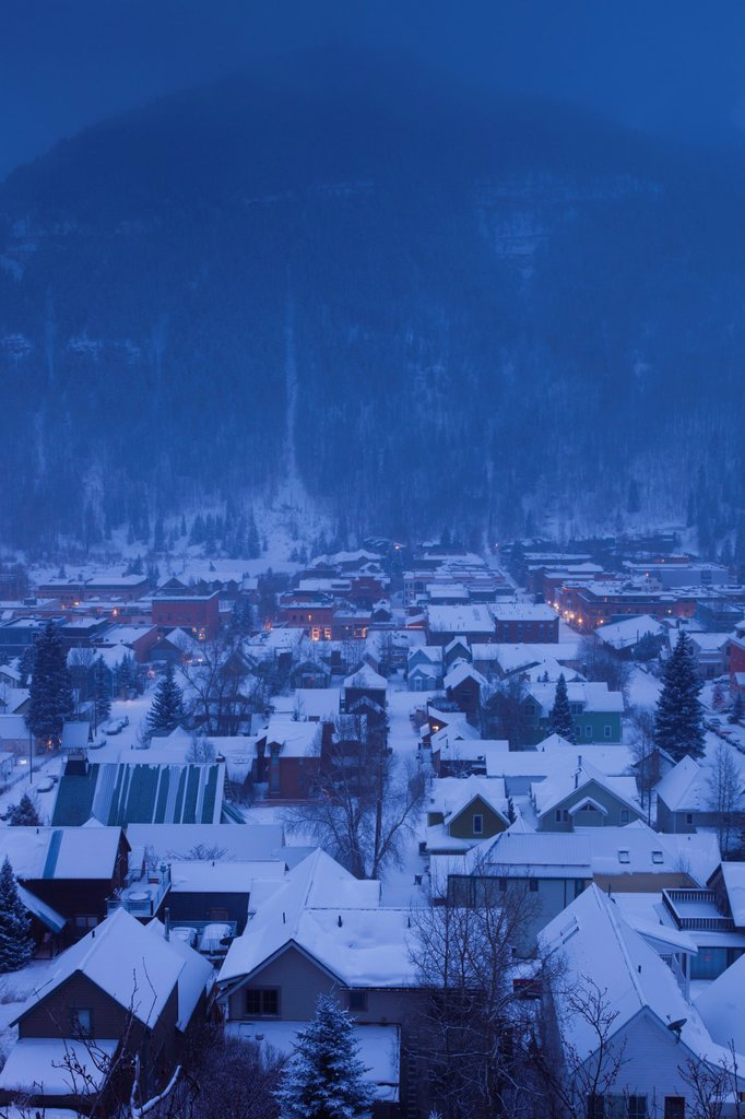 Stock Photo: 1566-1040629 USA, Colorado, Telluride, elevated town view from Tomboy Road in snowstorm, dawn