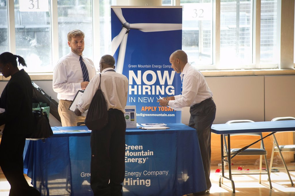 Job seekers attend a job fair in the East Harlem neighborhood of New job fair is one of the many events occurring during the Harlem Week festivities : Stock Photo