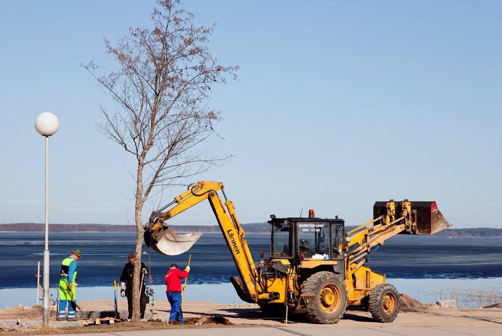 Stock Photo: 1566-1040899 Municipal workers building and paving a walkway at lake shore  Location Asemanlahti Pieksämäki Finland Scandinavia Europe