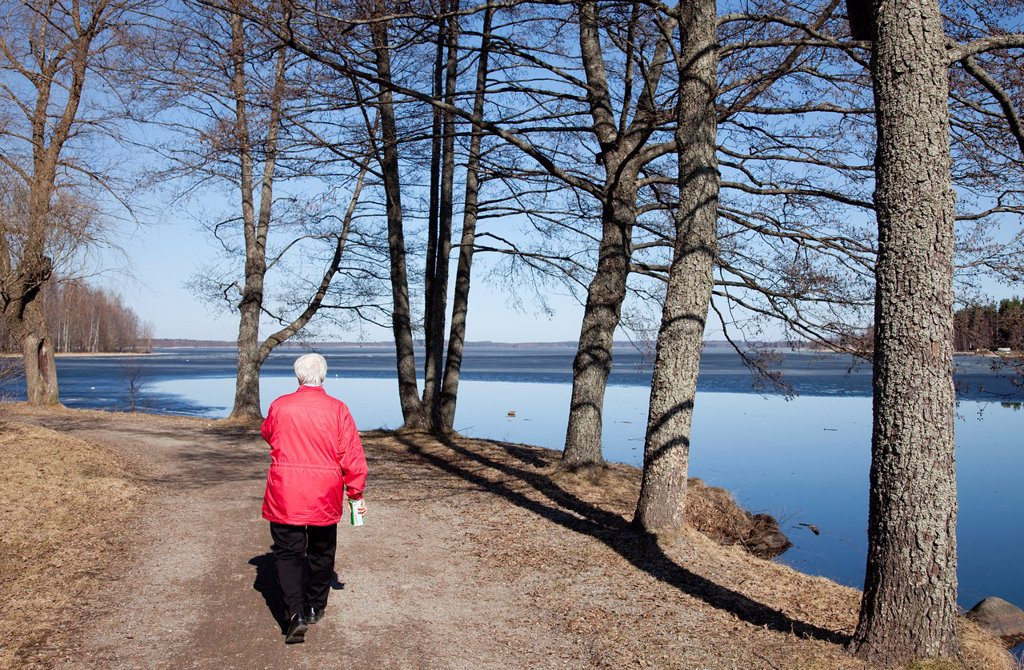 Stock Photo: 1566-1040901 Elderly woman walking at shore  Location Asemanlahti Pieksämäki Finland Scandinavia Europe