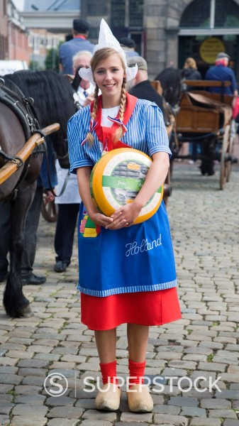 Pretty girl wearing national costume at the traditional cheese market, Gouda, Netherlands : Stock Photo