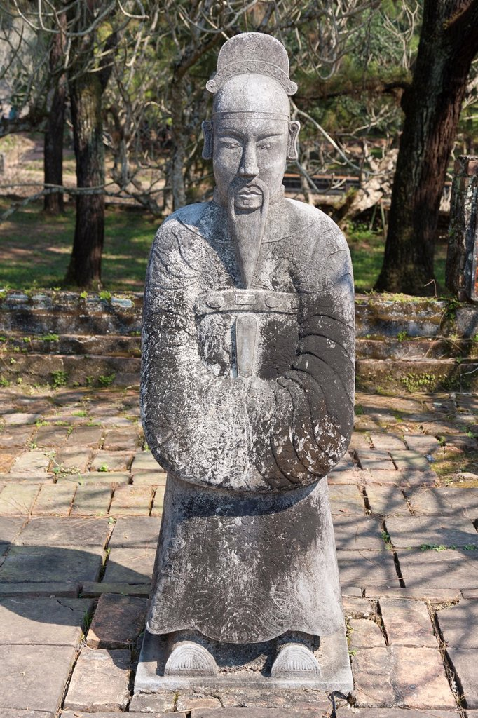 A stone statue of a man at the tomb of Emperor Tu Duc, near Hue, Vietnam : Stock Photo