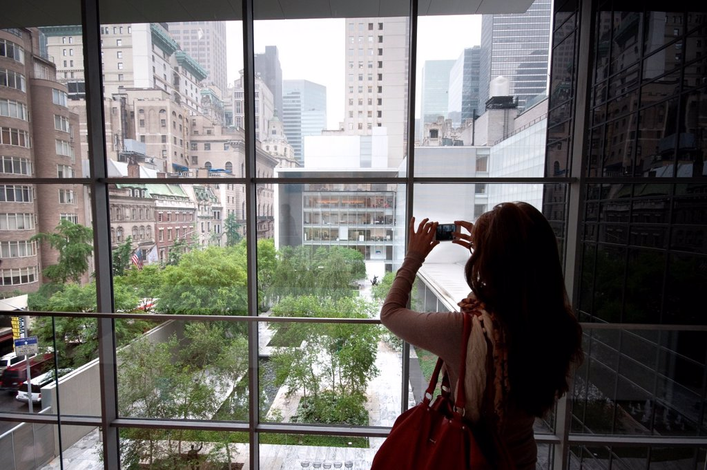 Stock Photo: 1566-1044553 USA, New York, New York City, Manhattan, Museum of Modern Art, MOMA, Woman Taking Picture Using an iPhone