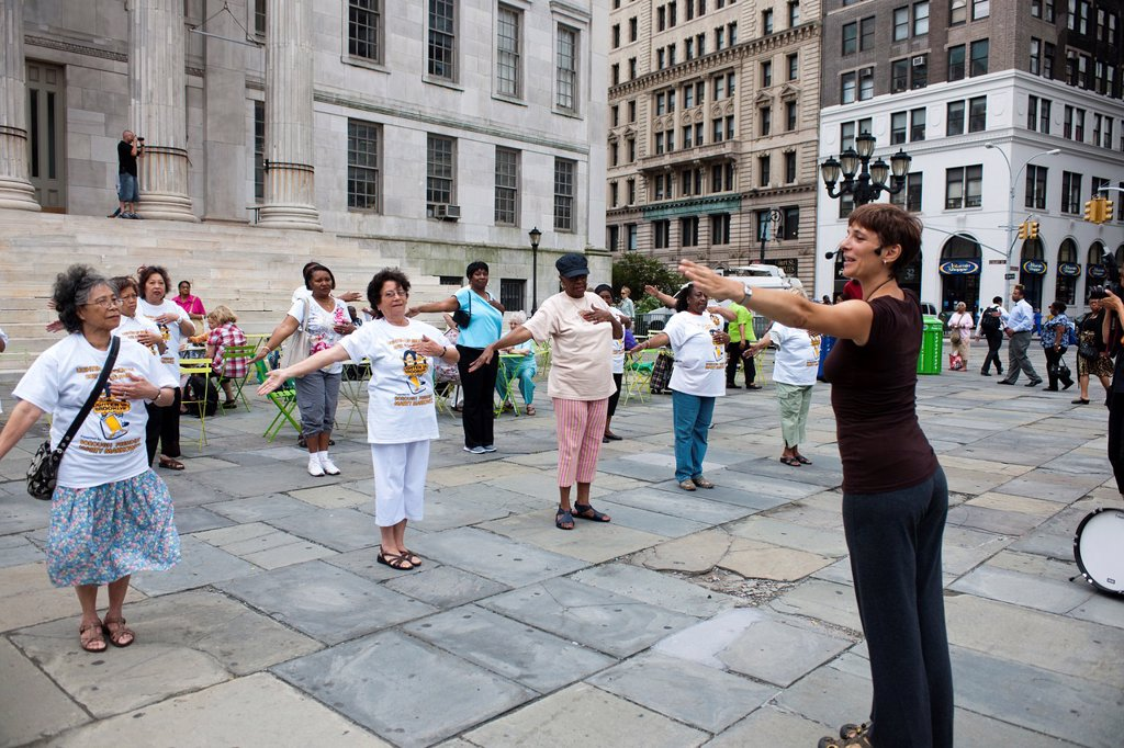 Senior citizens participate in a restorative movement class taught by a member of the Mark Morris Dance Company at Borough Hall in Brooklyn in New York during the Lighten Up Brooklyn Campaign The campaign encourages anti-obesity and healthy lifestyle acti. Senior citizens participate in a restorative movement class taught by a member of the Mark Morris Dance Company at Borough Hall in Brooklyn in New York during the Lighten Up Brooklyn Campaign The campaign encourages anti-obesity and healthy li : Stock Photo
