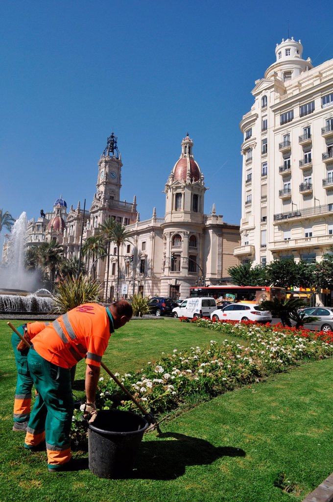 Stock Photo: 1566-1045811 Valencia, Spain: gardeners at work in Plaza del Ayuntamiento