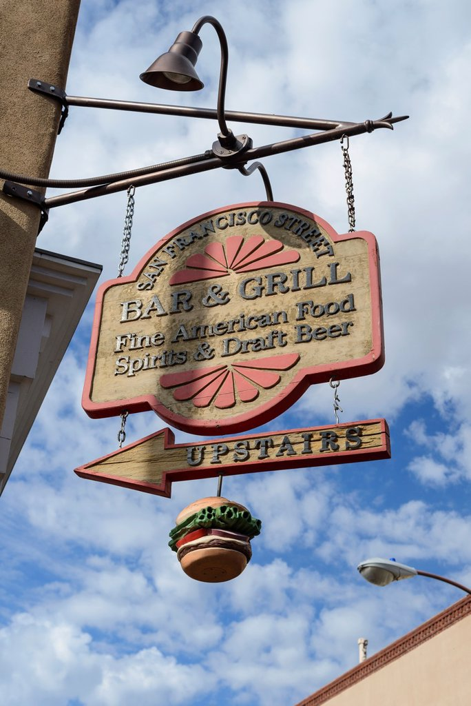 Hanging sign on street corner advertising bar and grill, downtown Santa Fe, New Mexico, USA : Stock Photo