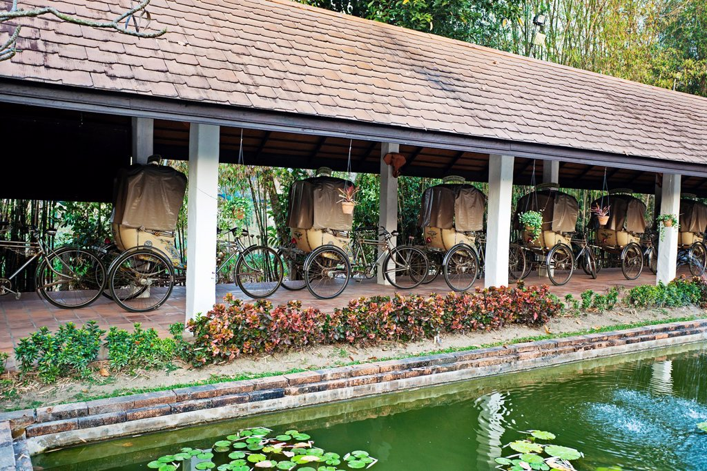 Rickshaws, The Legend hotel, Chiang Rai Province, Thailand. : Stock Photo
