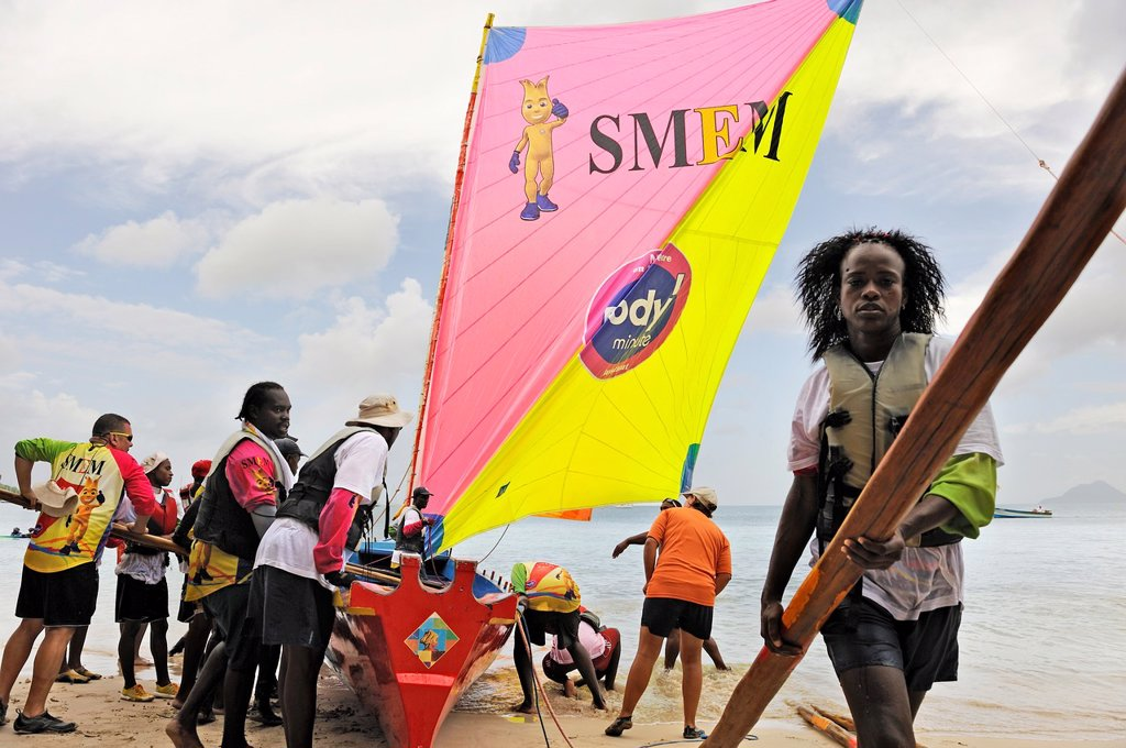 Stock Photo: 1566-1047516 preparation of the skiff before the race during the Yoles Festival, Sainte-Anne Bay, Martinique, french island overseas region and department in the Lesser Antilles in the eastern Caribbean Sea, Atlantic Ocean