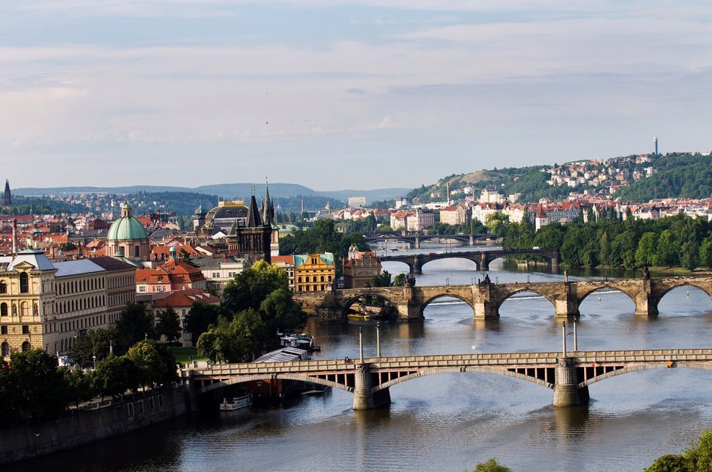 Stock Photo: 1566-1048668 A beautiful view of the Vltava river and the old bridges and buildings in Prague