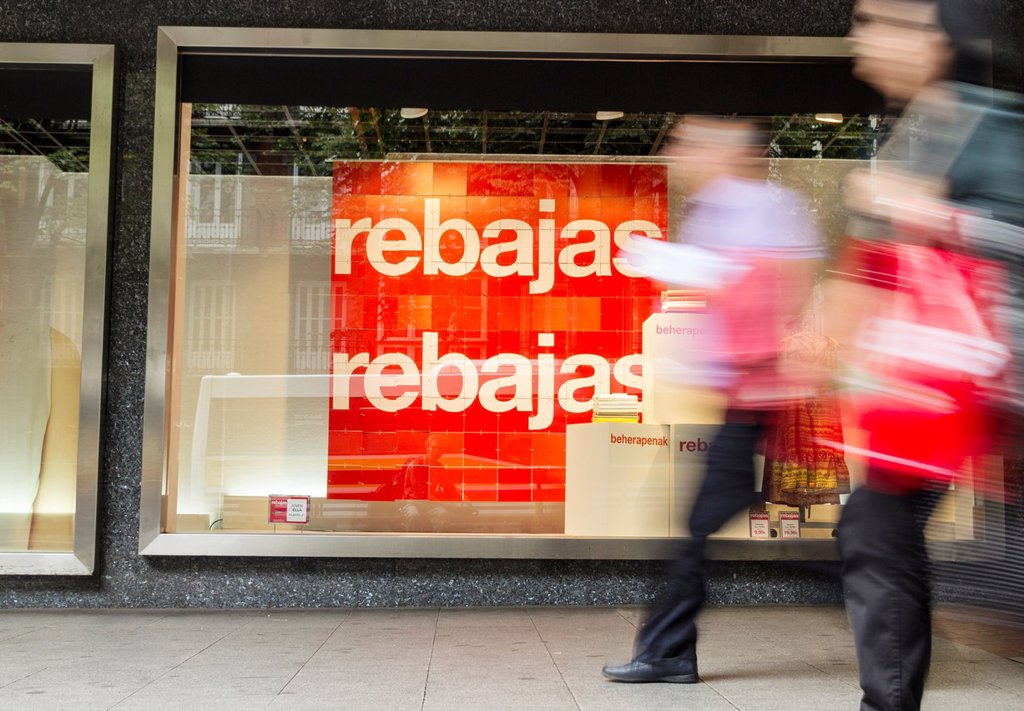 Stock Photo: 1566-1048856 Sales sign in Spanish Rebajas and Basque beherapenak in Corte Ingles store window in Bilbao, Basque country, Spain, Europe