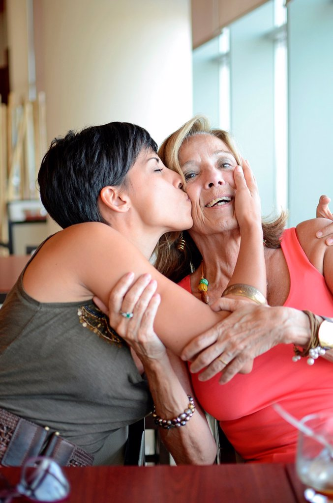 Stock Photo: 1566-1048871 Young woman kisses mature woman affectionately