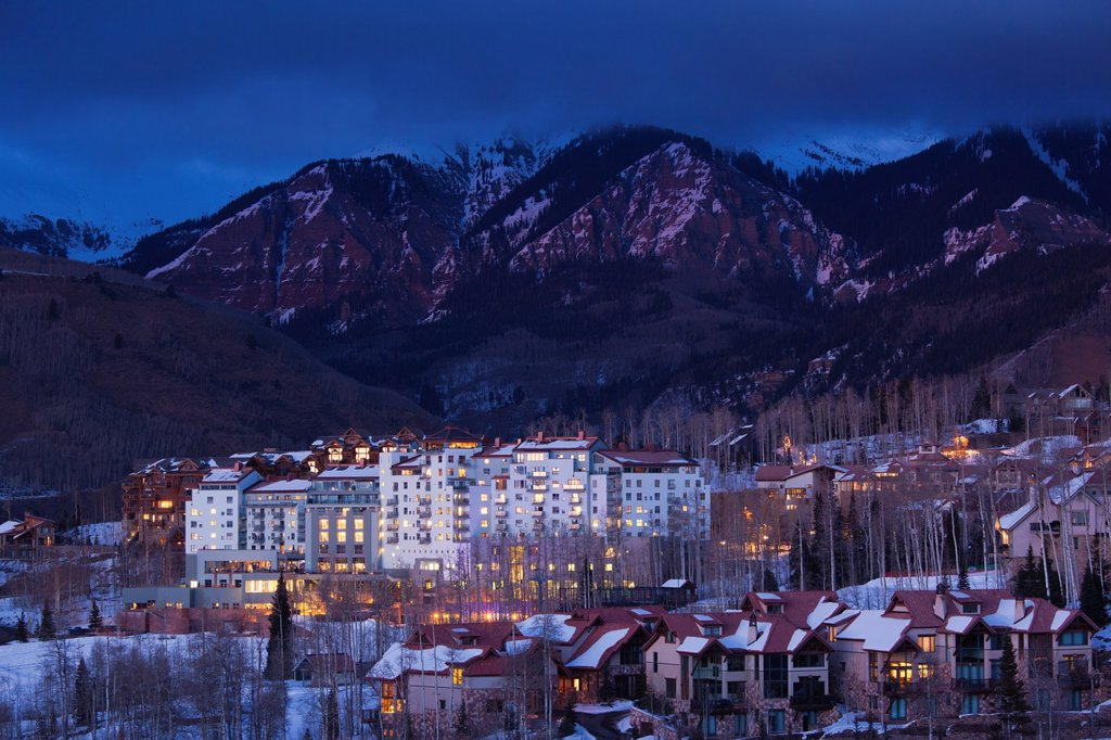 USA, Colorado, Telluride, elevated view of Mountain Village Ski Area and The Peaks Resort, dusk : Stock Photo