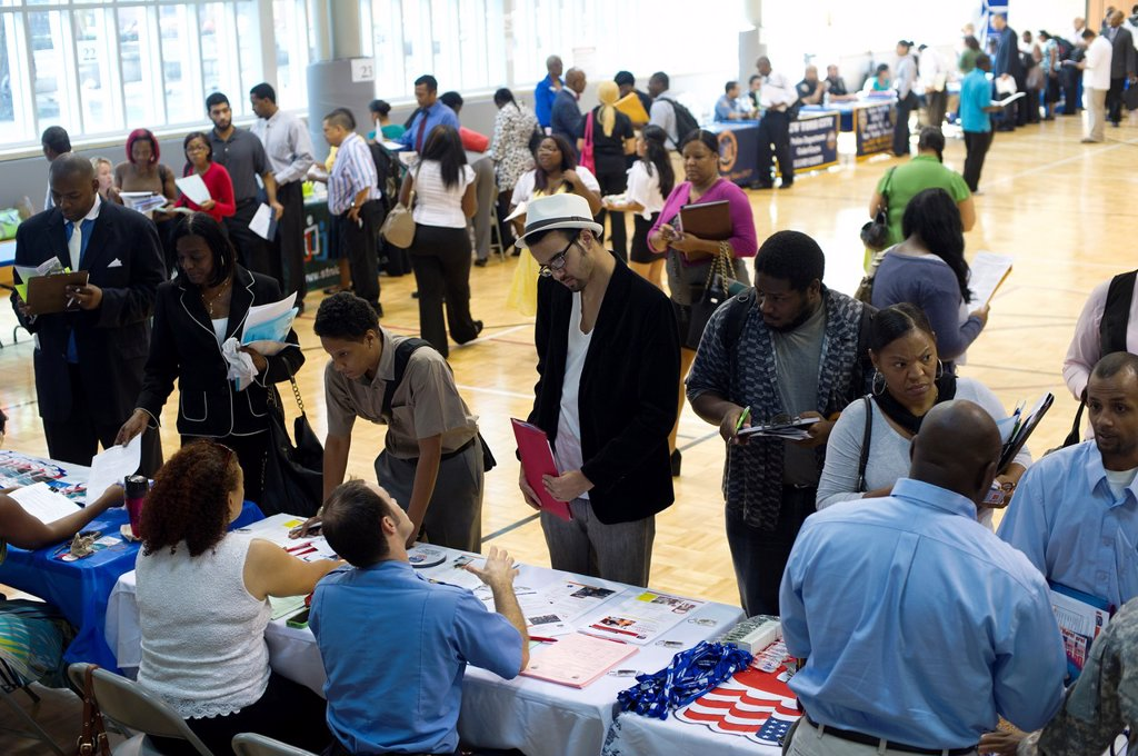 Stock Photo: 1566-1049603 Job seekers attend a job fair in the East Harlem neighborhood of New York The job fair is one of the many events occurring during the Harlem Week festivities