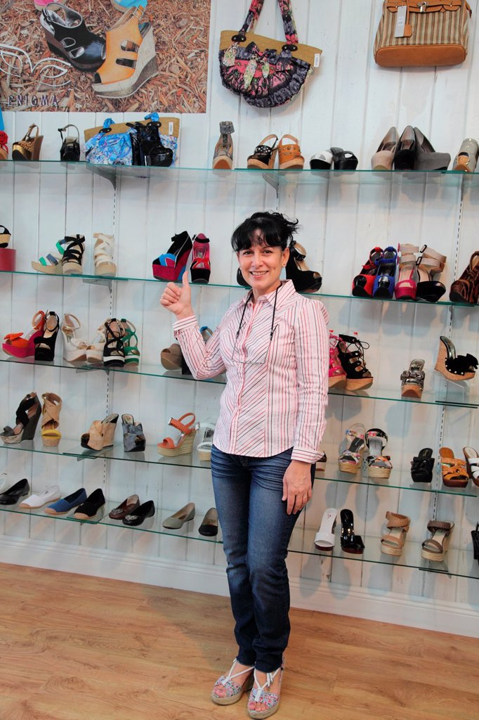 Stock Photo: 1566-1049618 Store clerk happy handbags and shoes that had a good day, Miami Beach, Florida, USA