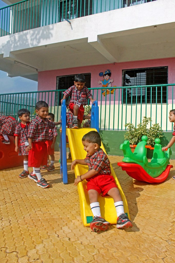 Stock Photo: 1566-1050518 children playing in schoolyard, aaryan school, pune, maharashtra, india