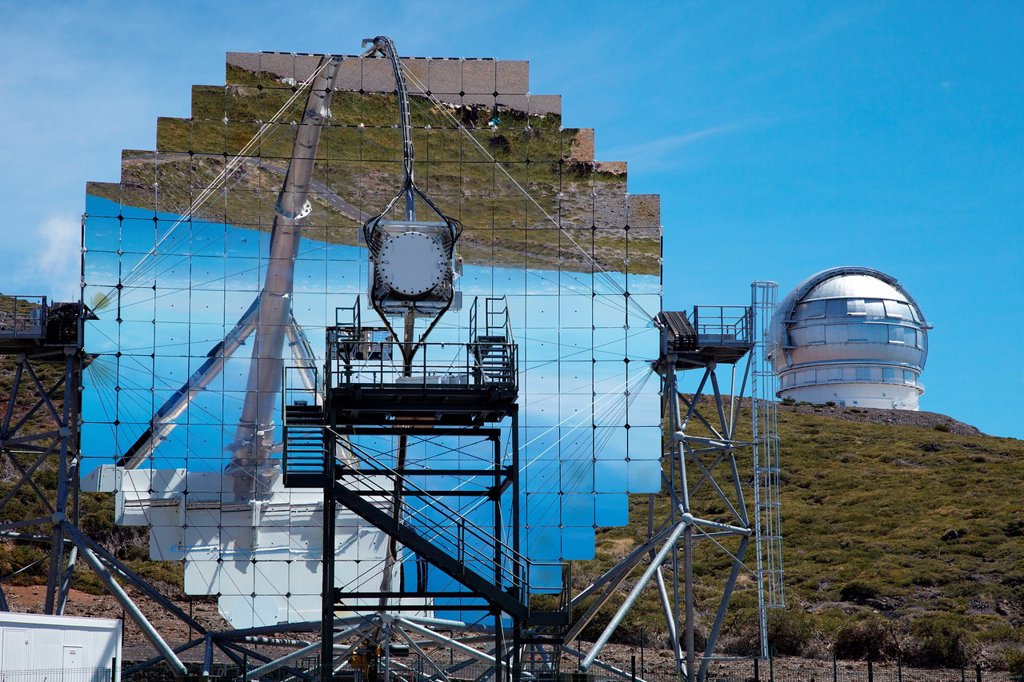 Stock Photo: 1566-1051343 The Magic Telescopes, Roque de los Muchachos Observatory, La Palma, Canary Islands, Spain   The cosmos and its evolution are studied using all radiation, in particular electromagnetic waves  The observable spectrum extends from radio waves to infrared, vi. The Magic Telescopes, Roque de los Muchachos Observatory, La Palma, Canary Islands, Spain   The cosmos and its evolution are studied using all radiation, in particular electromagnetic waves  The observable spectrum extends from radio waves to