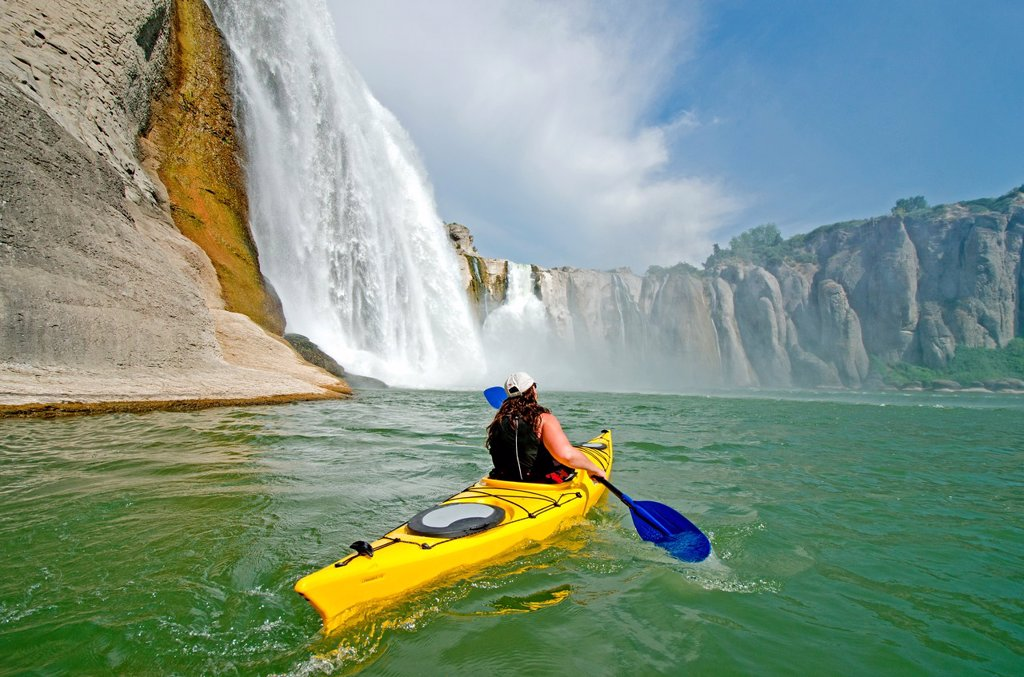 Stock Photo: 1566-1051586 Shelley Coleman kayaking on the Snake River below Shoshone Falls in the Snake River Canyon near the city of Twin Falls in southern Idaho