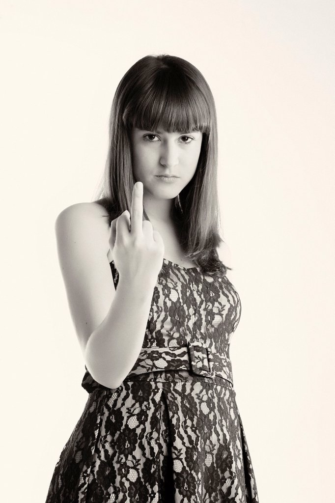 Girl lifting the ring finger : Stock Photo