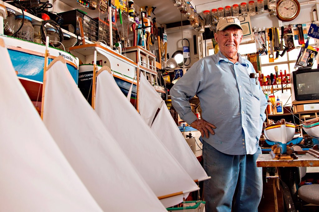 Stock Photo: 1566-1051650 Portrait of Vert Lowe master maker of ship models at his shop on Green Turtle Cay, Bahamas  Master modeler Vert Lowe produces scaled replicas of two-mast schooners and sloops