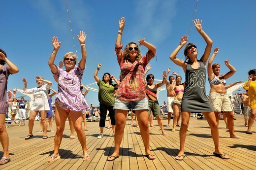 Women dancing on deck of cruise ship : Stock Photo