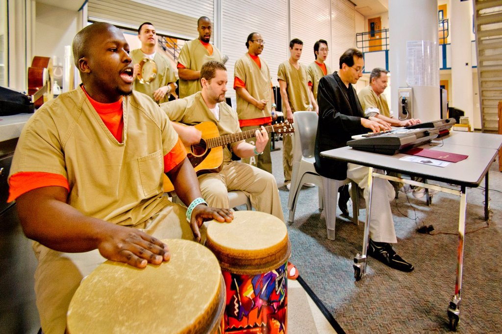 Stock Photo: 1566-1051735 A prison band and choir of male inmates at the Santa Ana, CA city jail sings at graduation of a jail educational program