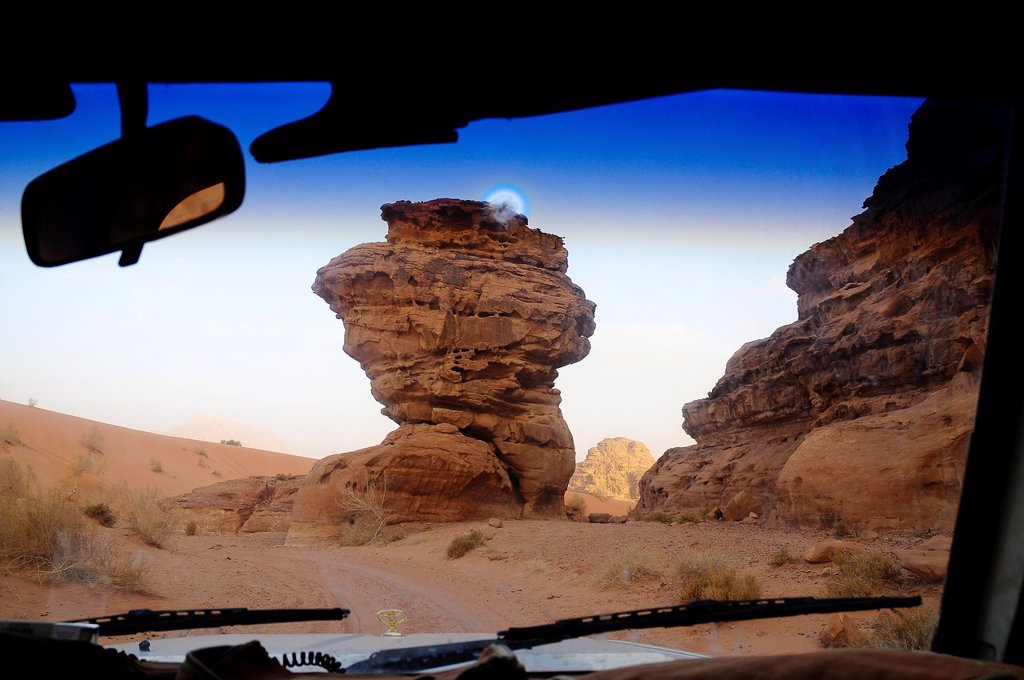 Stock Photo: 1566-1053355 Rock formations from a car front window, Wadi Rum desert, Jordan, Middle East