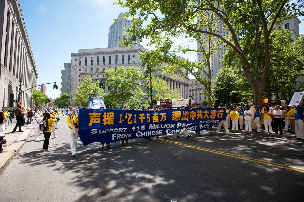 Stock Photo: 1566-1053798 Carrying banners and signs members of Falun Dafa Falun Gong from around the world parade through the streets of Chinatown in New York Practitioners of Falun Dafa claim that they are being persecuted by the government in China for their spiritual beliefs