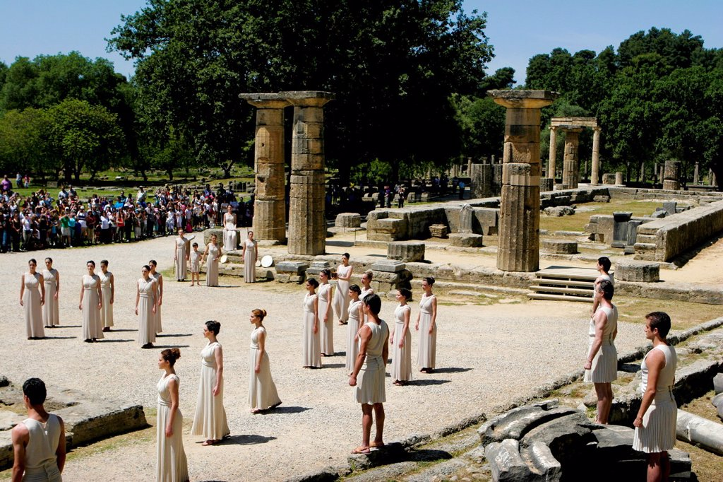 Stock Photo: 1566-1055276 April 9, 2012 Olympia Greece  Actors take part in a dress rehearsal for the torch lighting ceremony of the London 2012 Olympic Games at the site of ancient Olympia