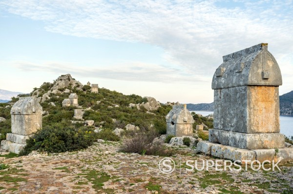 Lycian rock tombs, Kaleköy, Üçagiz Teimiussa, Antalya Province, Turkey : Stock Photo