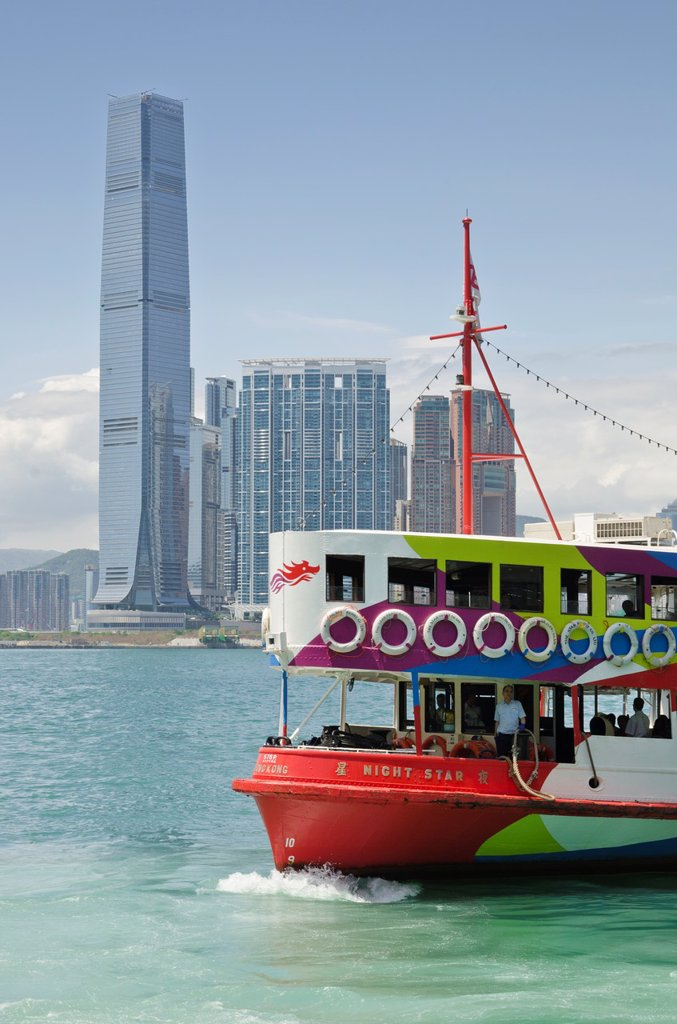 Stock Photo: 1566-1055529 A Star Ferry in Victoria Harbour with the Hong Kong waterfront development of Union Square in the background, Hong Kong, China