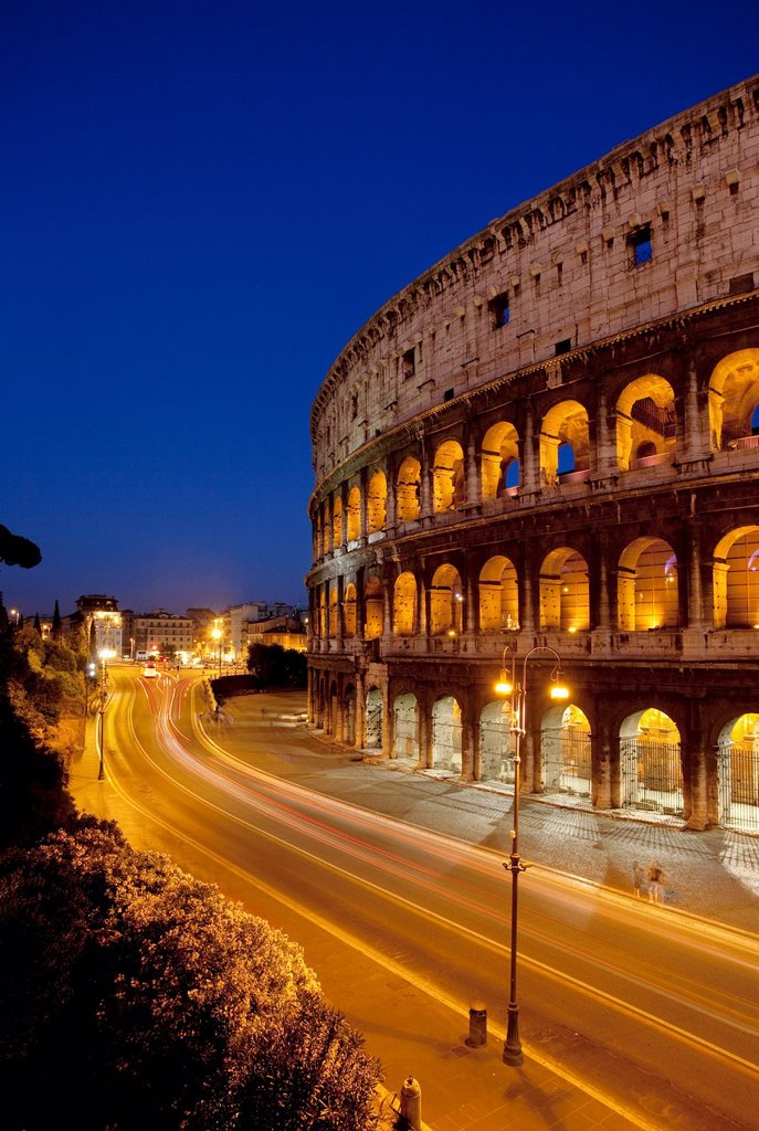 Stock Photo: 1566-1055824 Car light-trails in front of the Roman Coliseum at dusk, Rome Lazio Italy