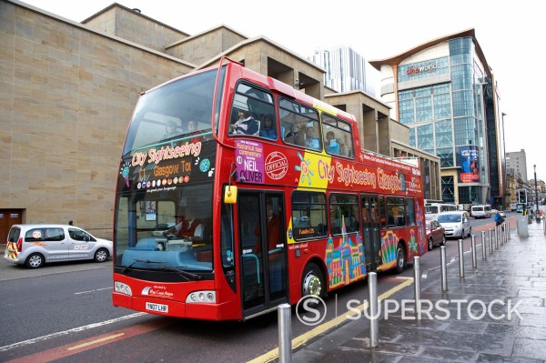 red city sightseeing tourist open top tour bus in the rain Glasgow Scotland UK : Stock Photo