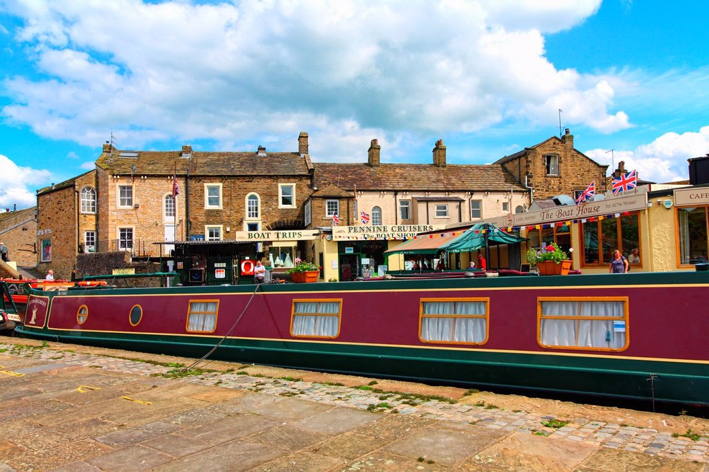 Stock Photo: 1566-1058093 Skipton also known as Skipton-in-Craven is a market town and civil parish in the Craven district of North Yorkshire, England  It is located on the course of the River Aire and the Leeds and Liverpool Canal to the south of the Yorkshire Dales,