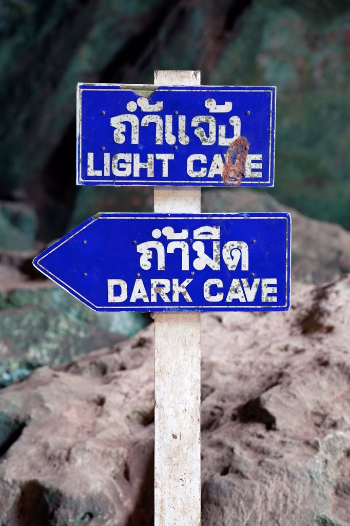 Stock Photo: 1566-1059223 Sign for ´Light Cave´ and ´Dark Cave´, Wat Tham Suwankhuha Heaven Grotto Temple, Phang-Nga Province, Thailand