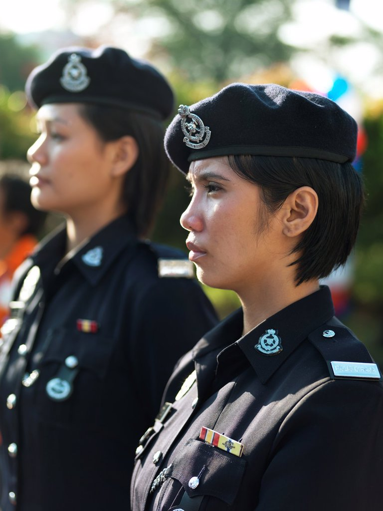Stock Photo: 1566-1060450 Two female soldiers standing in attention in Johor, Malaysia