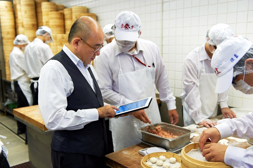 Stock Photo: 1566-1060828 Owner Warren Yang in the kitchen of the world famous Din Tai Fung Restaurant in Taipei, Taiwan
