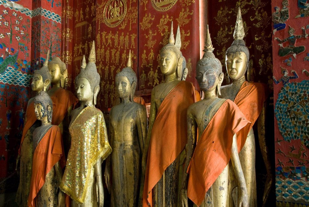 Stock Photo: 1566-1061557 Buddha statues in the Funerary Carriage Hall, Wat Xieng Thong, Luang Prabang, Laos