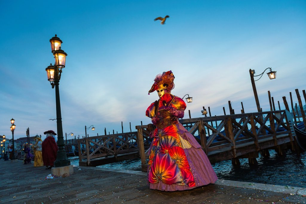 Stock Photo: 1566-1061968 A masked woman at the carnival in Venice, Italy, Europe