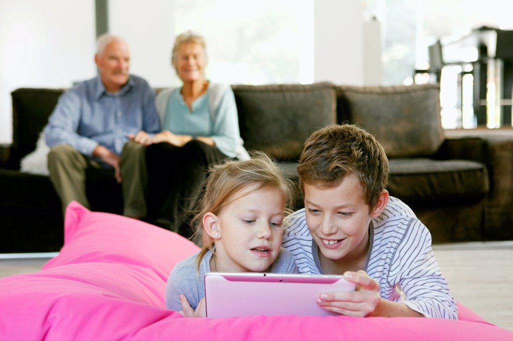 Stock Photo: 1566-1063172 Children using tablet computer